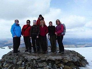 Debbie, second from right, on top of Ben Nevis, her first Munro