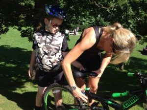 Adjusting a bike is all part of the cycling fun for a sporty mum! Pic credit Ellen Arnison