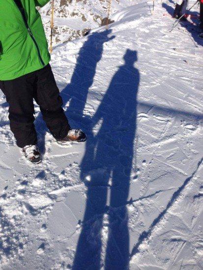 The shadow of a snow husky helmet cover.