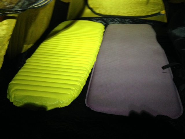 The yellow Neo Lite next to the purple traditional Therm-a-Rest.