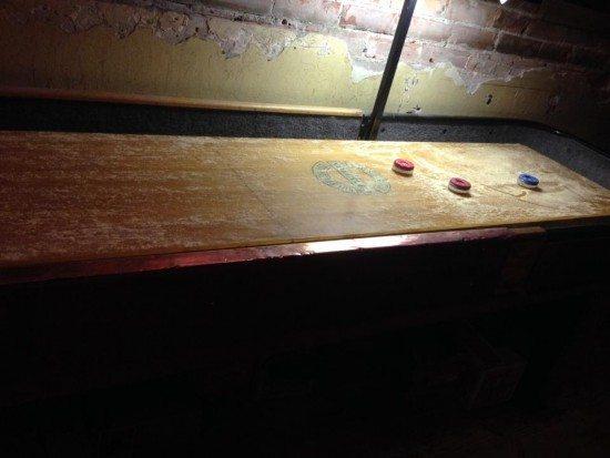 The fun pub games called shuffleboard.