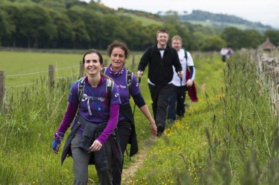 Chief Executive of Alliance Trust investment bank, Katherine Garrett-Cox (L) leads a group of walkers approaching West Gormack farm during the Alliance Trust Cateran Yomp in Perthshire, Scotland. This weekend (13 Ð 14 June 2015) 600 hikers from around the UK took part in the Alliance Trust Cateran Yomp across ScotlandÕs historic Cateran Trail, now the largest fundraising event in Scotland for ABF The Soldiers' Charity.  152 teams and a total of 600 competitors including 217 serving soldiers and veterans trekked 22 miles, 36.5 miles or the full leg-sapping 54 miles around ScotlandÕs historic Cateran Trail in just 24 hours, a trail the Perth & Kinross Countryside Trust would recommend taking 5 days to complete.  Yomping home in first place in a time of 10 hours and 43 minutes were Army Reserves from 1ISR Brigade, the Army's Intelligence, Surveillance & Reconnaissance specialists. A spokesperson said Òthis is the first time the new 3 Witches Racing Team has taken part in the Cateran Yomp and we achieved what we came here to do, which is take the Gold medal back with us. Our team motto ÔSomething wicked this way comethÕ kept our focus. While a dayÕs ÔyompÕ, a military term for a long distance march represents a typical shift for professional soldiers; it is a major test for both civilian ÔyompersÕ and seasoned outdoor adventurers alike. But unlike everyday soldiers, this ÔCateran ArmyÕ swapped ration tins for indulgent pick me ups to consume en route including boar burgers, cheeseboards, local strawberries and fruit smoothies. This annual event has raised a grand total of £1.5 for ABF The SoldiersÕ Charity and the Alliance Trust Staff Foundation, which directs funding to community groups, local charities and voluntary organisations, nominated and voted for by Alliance Trust staff.