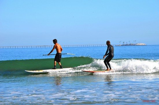 SUPs and surfing. Pic credit: B Garrett on Flickr Creative Commons