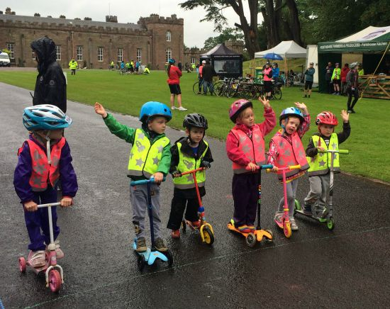Kids start their scooter race.