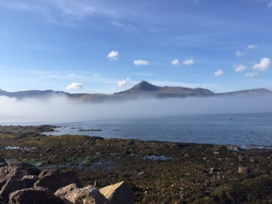 Goatfell behind the clouds seen from Brodick, Arran.