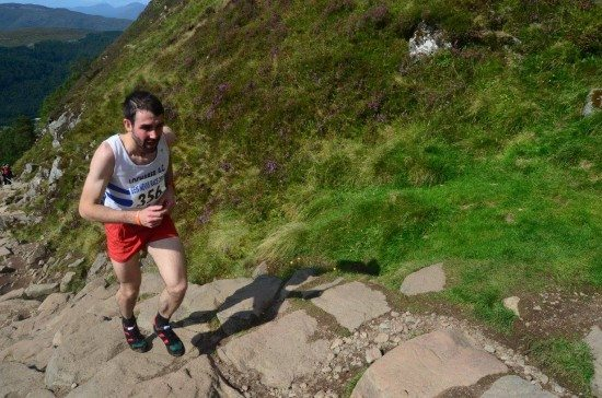 Finlay Wild races to the top of the Ben. Pic credit: John O'Neill