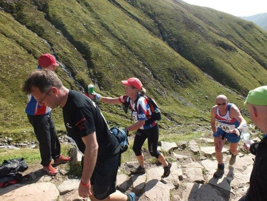 Mandy picks up water on the warm run uphill. Pic credit: Richard Airlie Gilbert