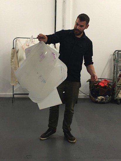 Alec holds up a pattern for a Trakke bag.