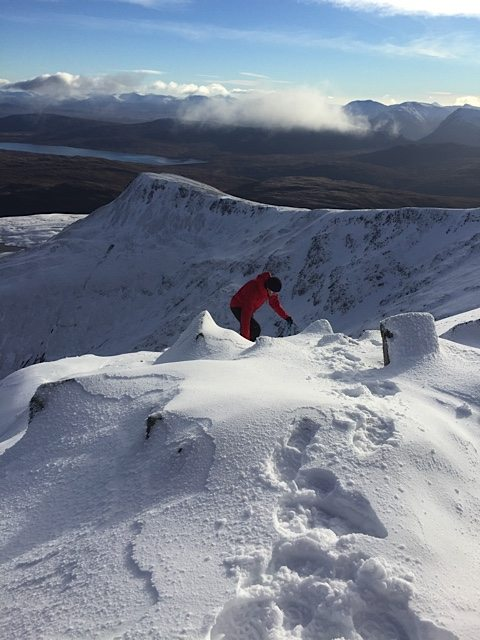 Dan climbs towards the summit of the first Munro.
