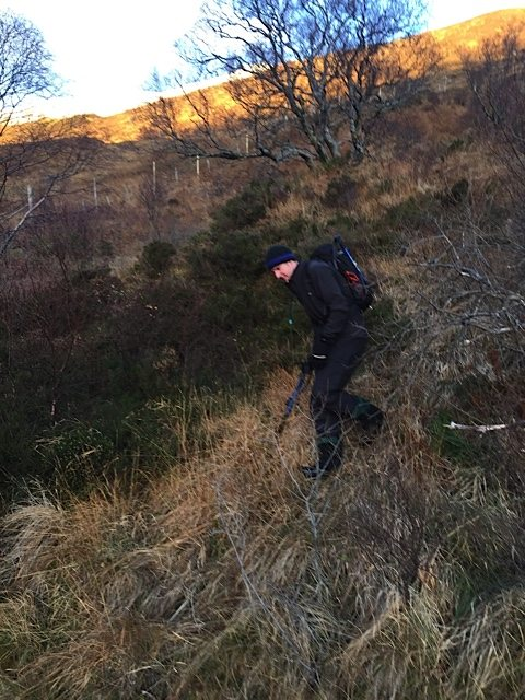 Dan makes his final steps off the rough hillside to reach the main track back to Grey Mare's Tail car park.