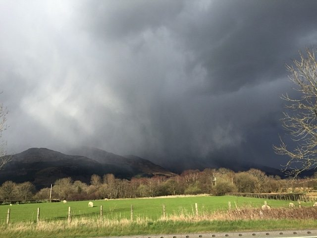A storm gathers over the Lake District mountains.