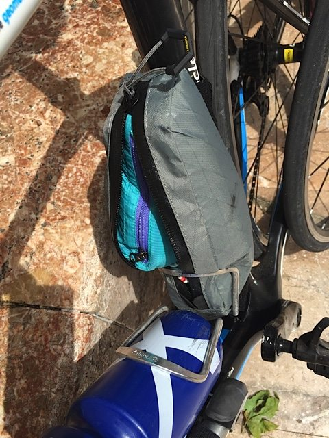 Squeezed into a bike bag in a bottle cage.