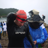 Lexi exits the swim.