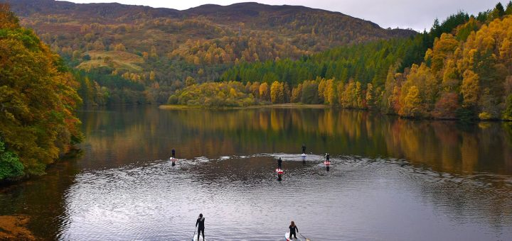 SUPs on Loch Faskally. Pic credit: Wilderness SUP Co.