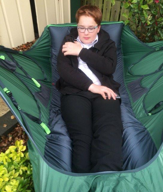 Rowan tests the hammock in his back garden.