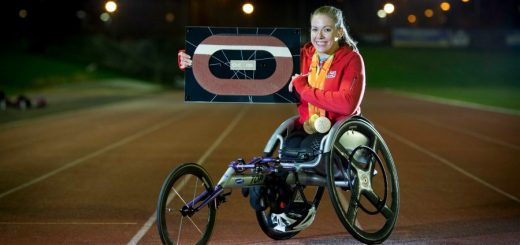 Hannah Cockroft with a framed piece of London 2012 track.