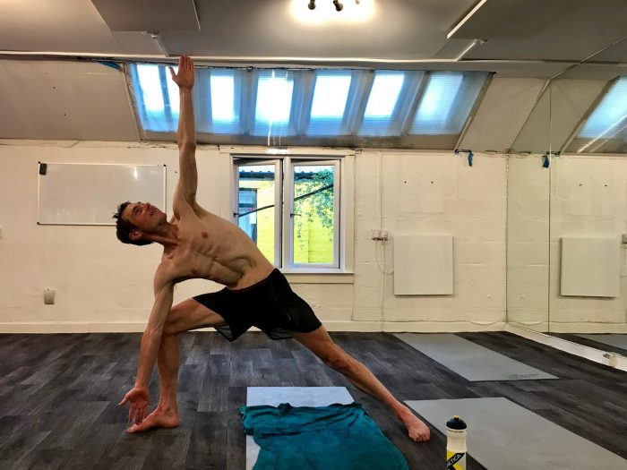 Tom practises daily hot yoga.