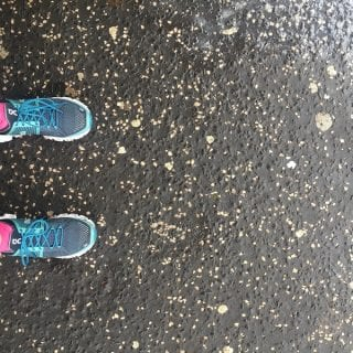 ON Running trainers on a pavement