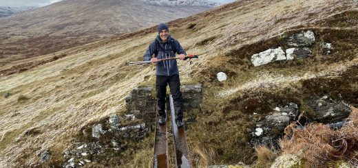 Ben crosses one of the iron girder bridges in Glen Lochay.
