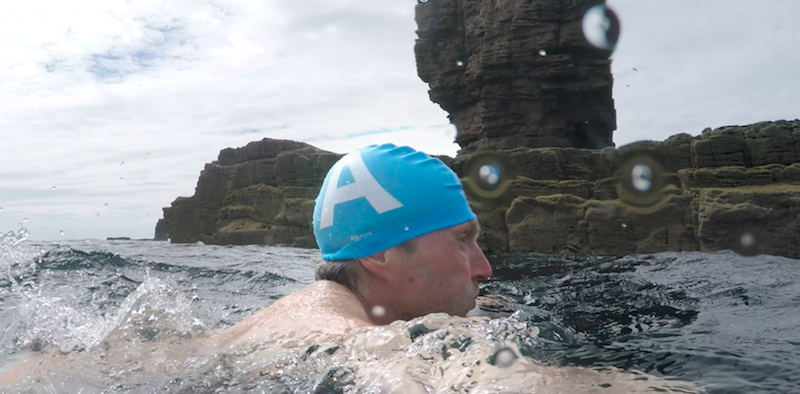 Széll swimming to the base of Am Buachaille (photo Keith Partridge)