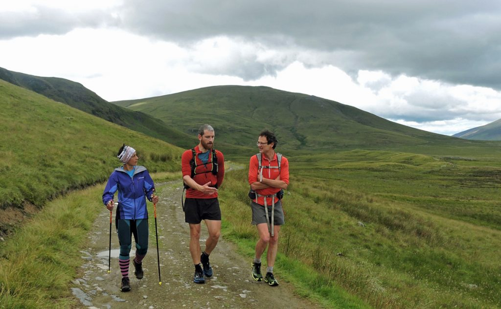 Sabrina Verjee discusses routes with Paul Tierney (centre) and Steve Birkinshaw during her 2020 Wainwrights round - photo by Chris Lines